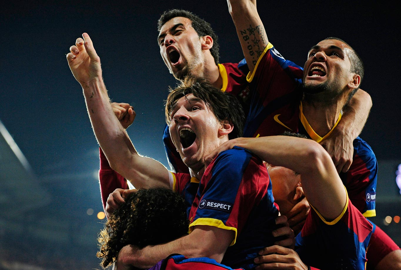 Barcelona's Lionel Messi celebrates with teammates after scoring against Real Madrid during their semifinal, 1st leg Champions League soccer match on April 27, 2011 at the Santiago Bernabeu Stadium in Madrid, Spain.