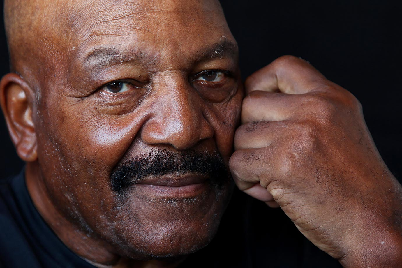 "Jim Brown poses for a portrait as part of Sports Illustrated's ""Where Are They Now"" issue in 2011. He is the only player to be inducted into the College Football, Pro Football and Lacrosse Halls of Fame."