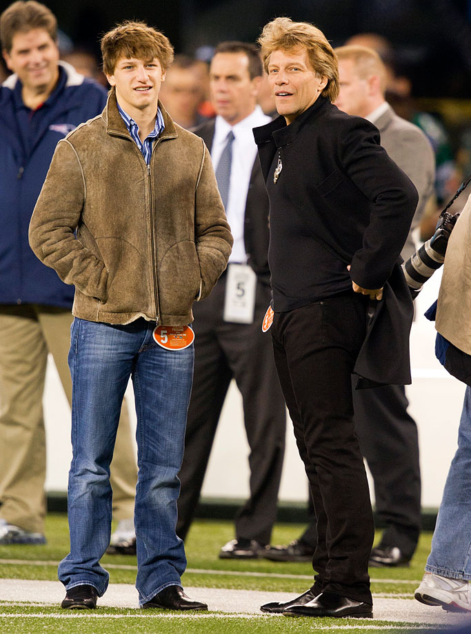Jon Bon Jovi and his son Jesse watch from the sidelines as the New England Patriots and the New York Jets play at MetLife Stadium in East Rutherford, NJ.