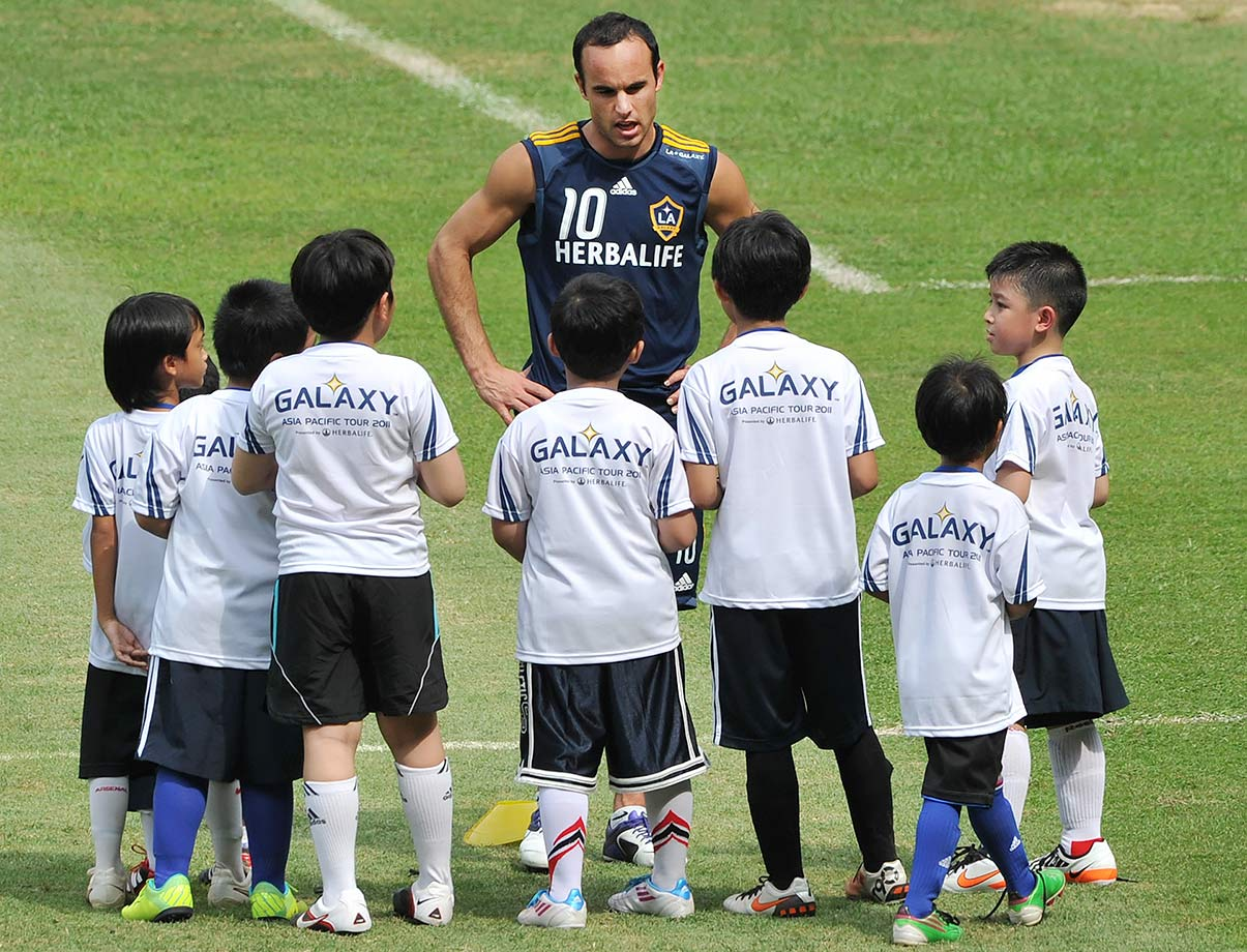 Indonesian students listen to Landon Donovan during a soccer clinic in Jakarta. The L.A. Galaxy visited Indonesia as part of their Asia tour.