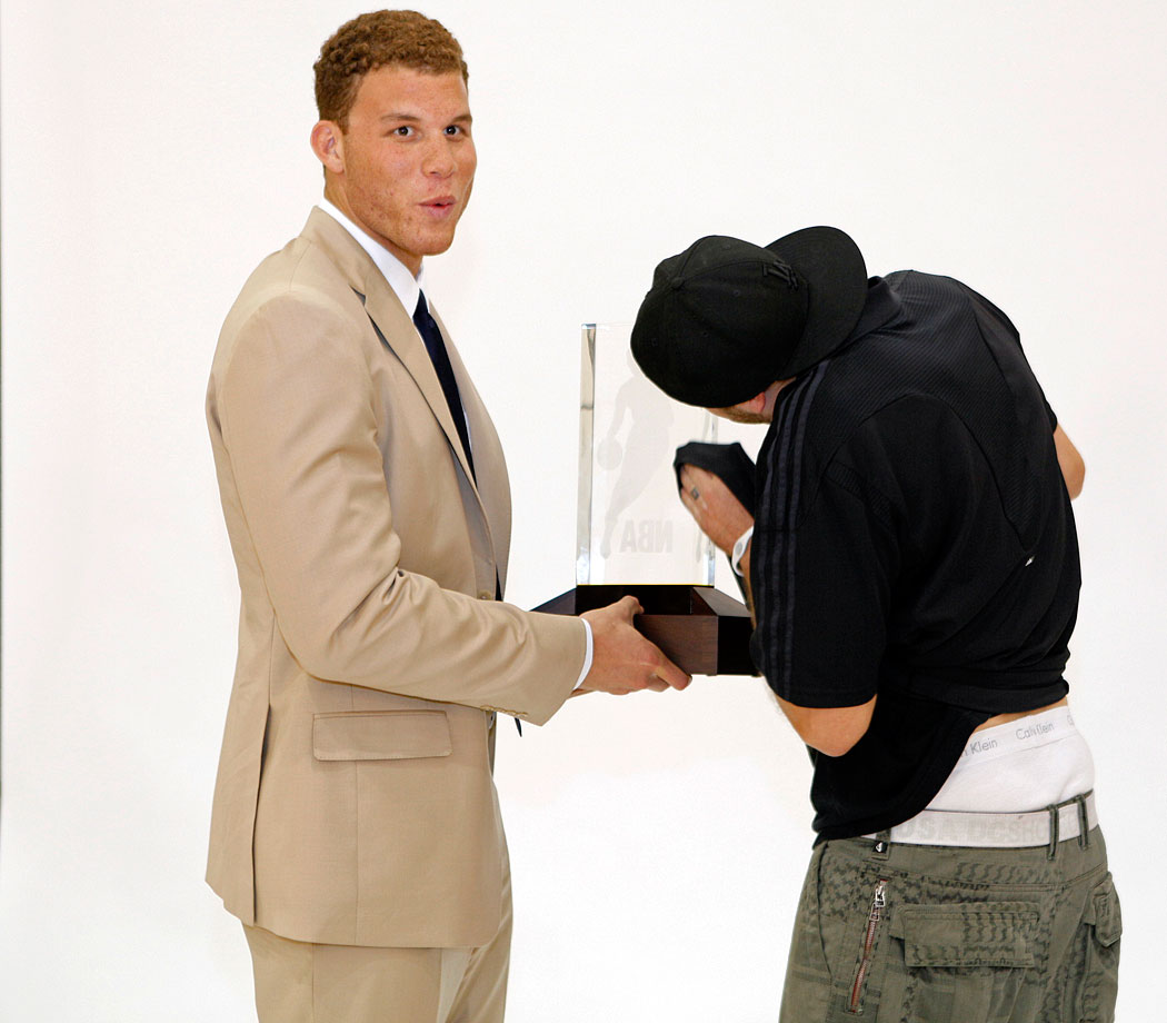 Blake Griffin gets his Rookie of the Year trophy polished during a photo shoot.
