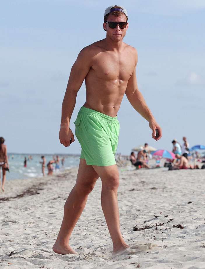 Blake Griffin, on a beach. Yeah, he must workout.