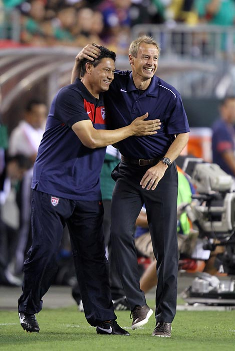 Klinsmann and assistant coach Martin Vazquez celebrate a goal by Robbie Rogers against Mexico on Aug. 10, 2011. A few weeks earlier, on July 29, Klinsmann was named coach of the United States national team after rumors linked the two for years.