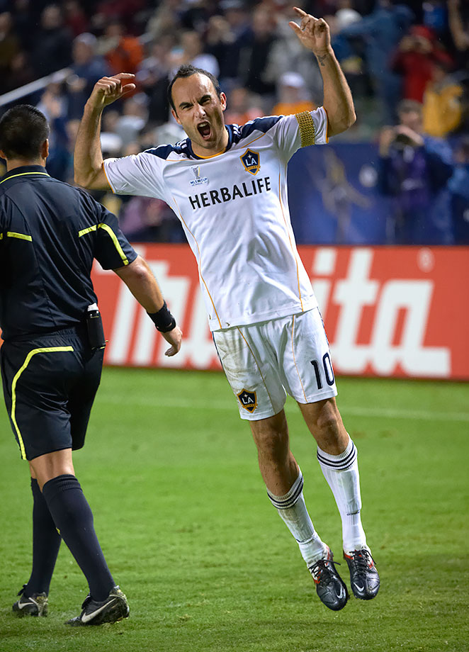 Landon Donovan celebrates during the 2011 MLS Cup between the Los Angeles Galaxy and Houston Dynamo at The Home Depot Center in Carson, Calif.