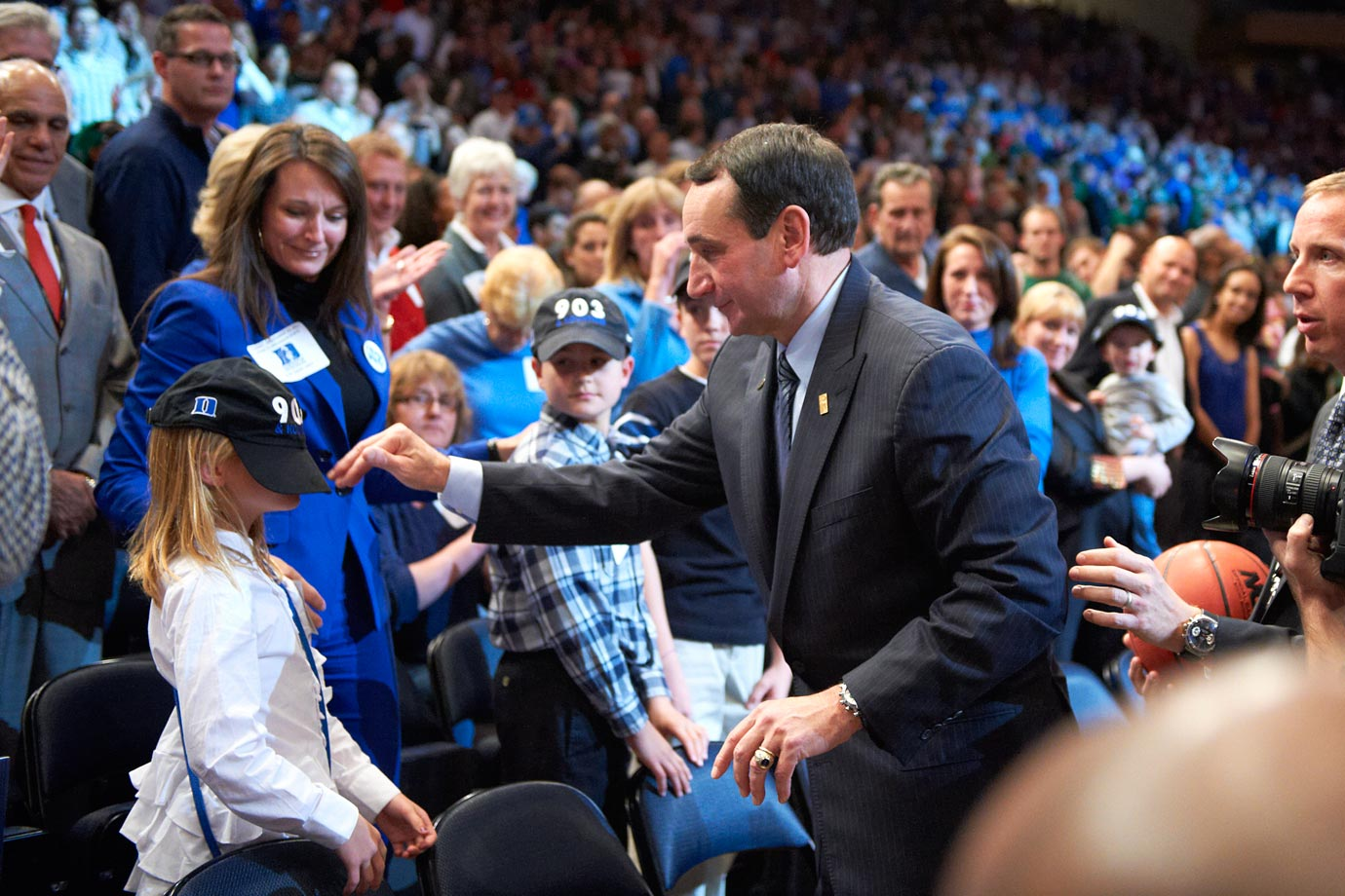 Mike Krzyzewski has a little fun with a young fan after winning his 903rd game to become the all time winningest men's coach in 2011 at Madison Square Garden. Duke defeated Michigan State 74-69.