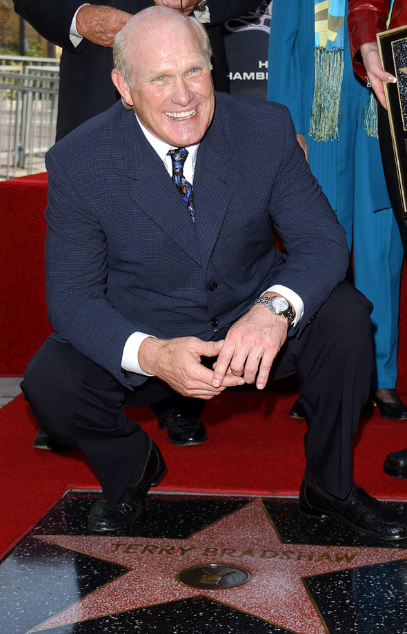 Terry Bradshaw makes an honorary kneel-down in front of his Hollywood Walk of Fame star. He was honored on Oct. 11, 2001.