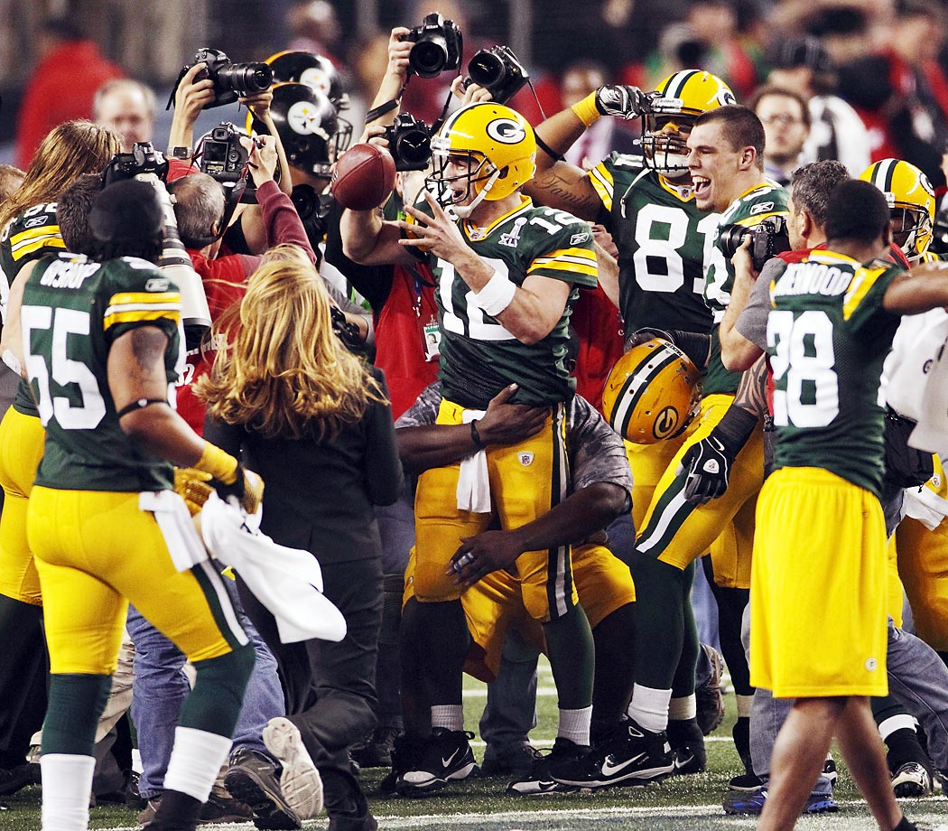 Aaron Rodgers celebrates at the end of a MVP-performance in which he threw three touchdown passes.