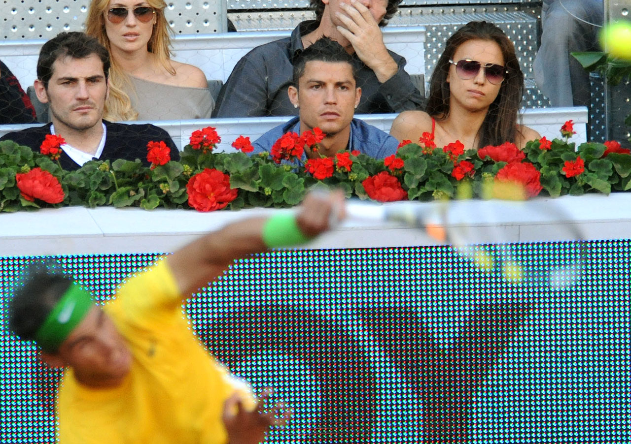 Cristiano Ronaldo and girlfriend, model Irina Shayk, watch Rafael Nadal serve during a tennis match on day nine of the Mutua Madrilena Madrid Open.