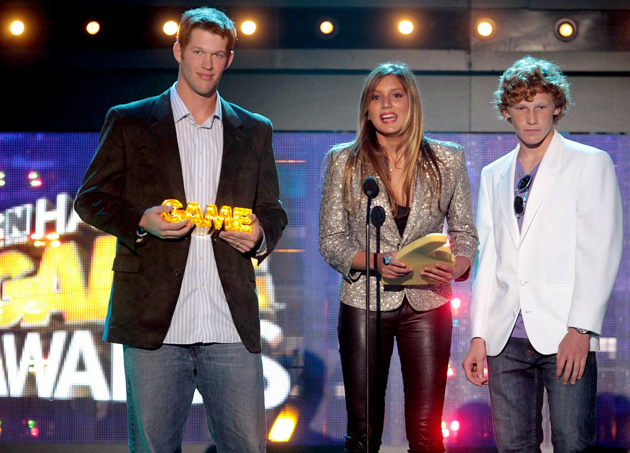Clayton Kershaw presents an award alongside Maya Gabeira and Noah Fiegel during the 2nd Annual Cartoon Network Hall of Game Awards at the Barker Hangar of Santa Monica Airport on Feb. 18, 2012 in Santa Monica, Calif.