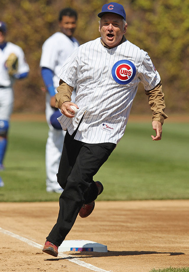 Bill Murray runs the bases before throwing out the ceremonial first pitch for the Chicago Cubs game against the Washington Nationals during opening day on April 5, 2012 at Wrigley Field in Chicago.