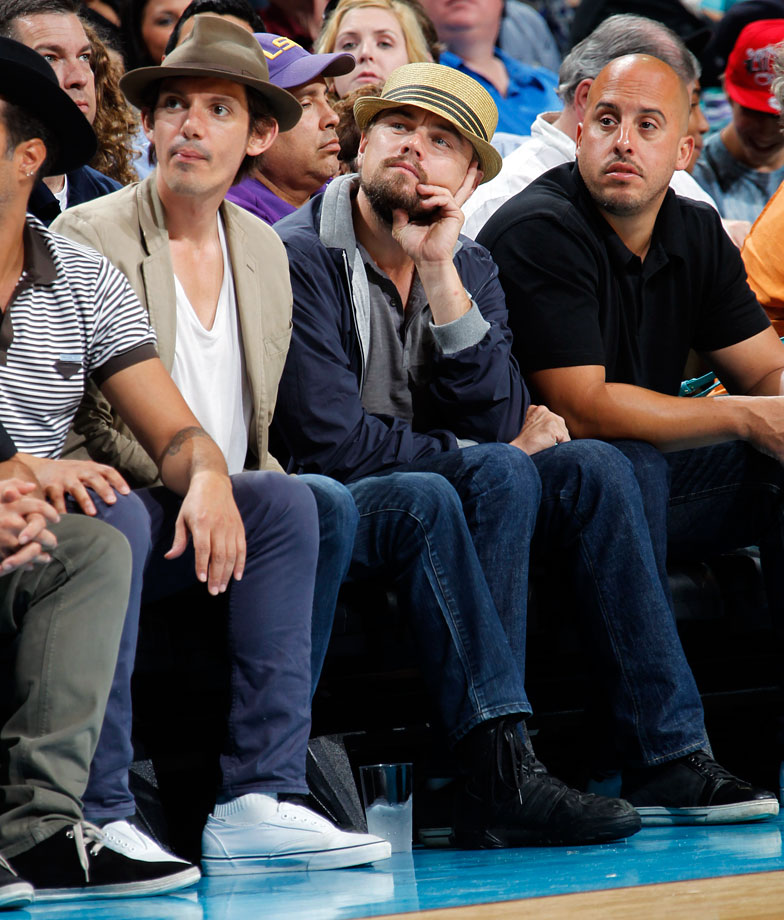 Leonardo DiCaprio and Lukas Haas (left) attend the Los Angeles Lakers game against the New Orleans Hornets at the New Orleans Arena.