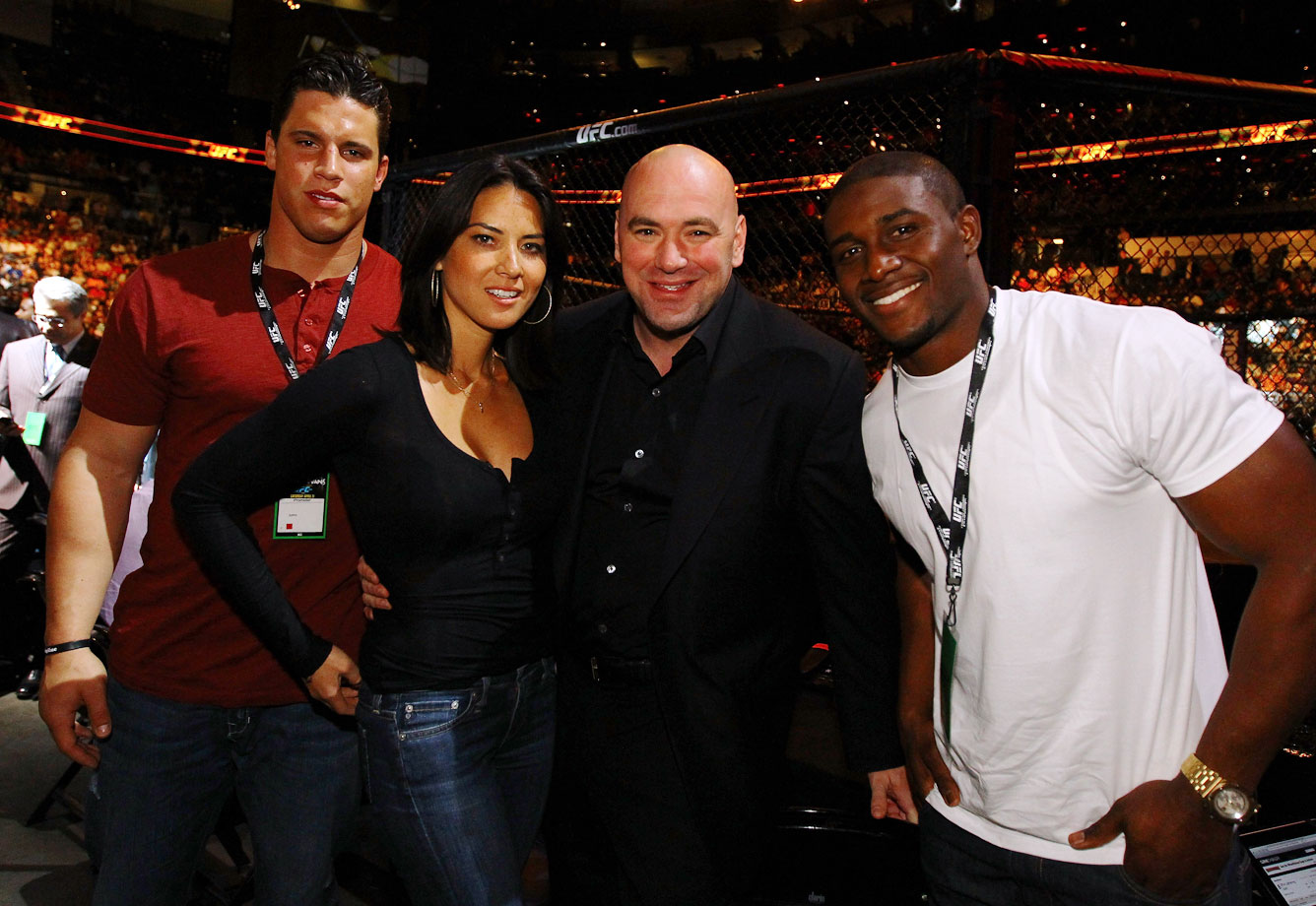 Olivia Munn, UFC President Dana White, and Reggie Bush attend UFC 145: Jones v Evans at Philips Arena on April 21, 2012 in Atlanta.
