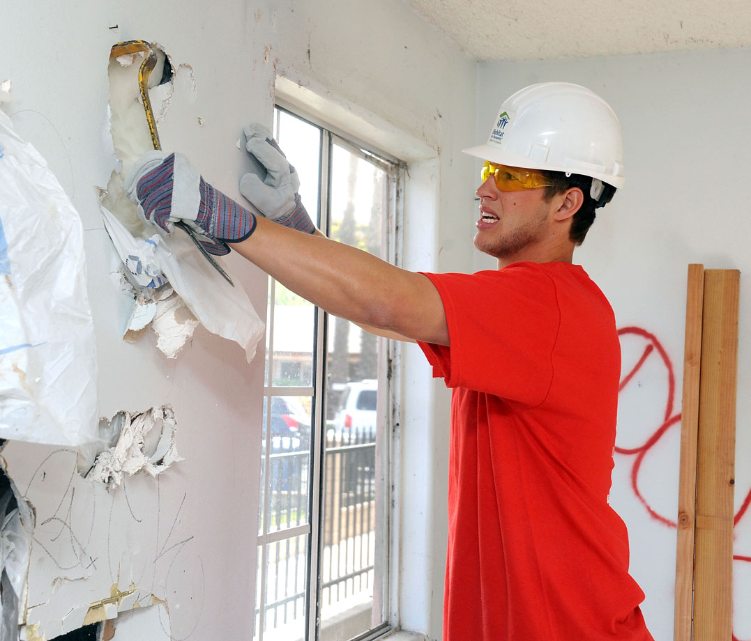 Clayton Kershaw works on the demolition of a wall during a Habitat For Humanity build event on April 24, 2012 in Lynwood, Calif.
