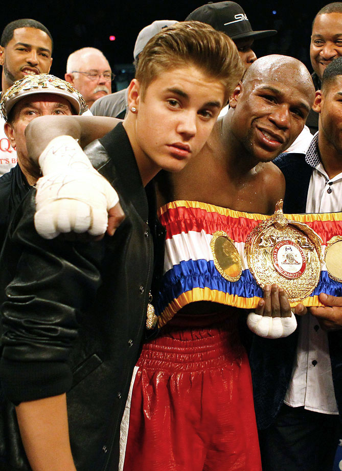 Justin Bieber and Floyd Mayweather Jr. pose together after Mayweather defeated Miguel Cotto by unanimous decision in their WBA super welterweight title fight on May 5, 2012 at the MGM Grand Garden Arena in Las Vegas.