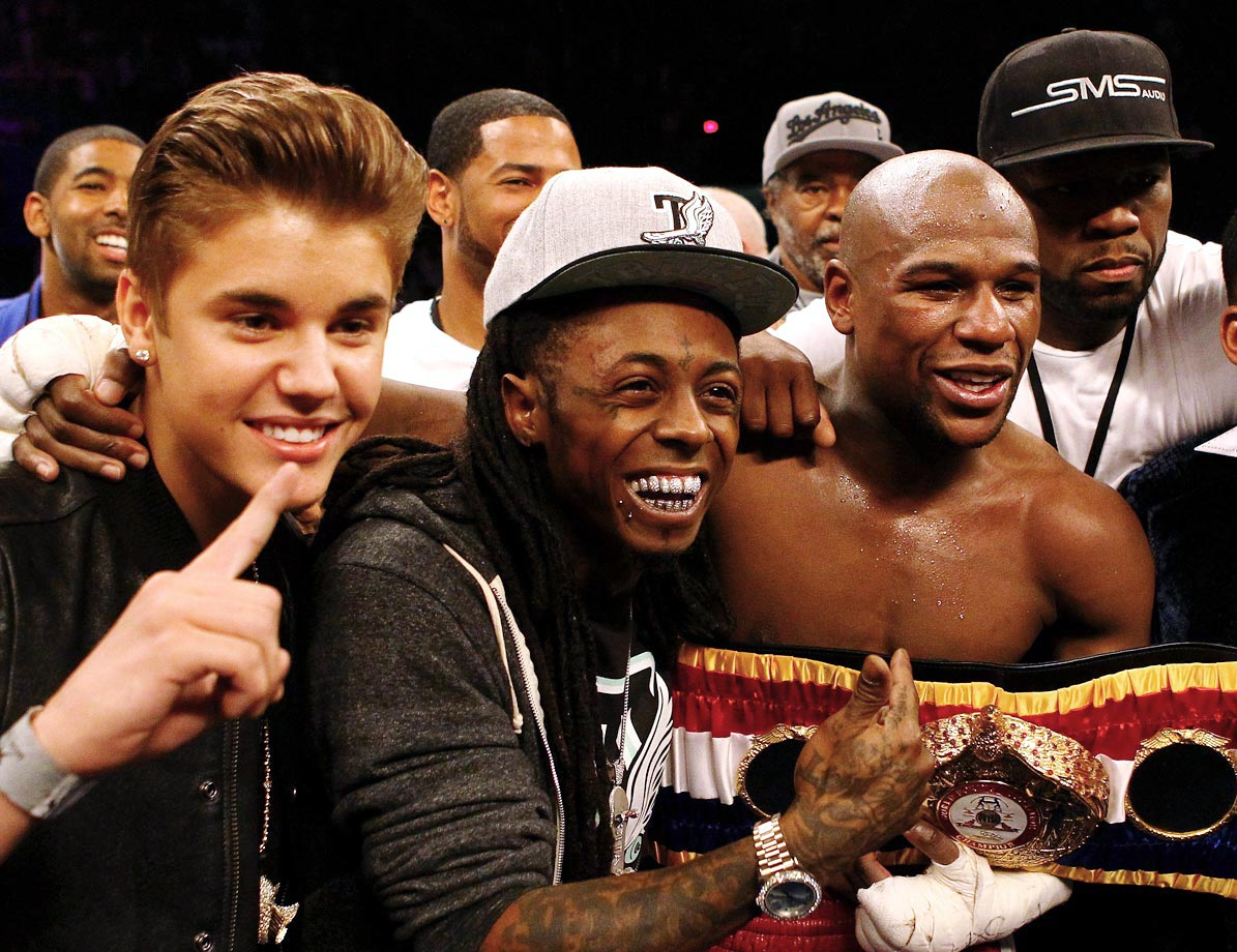 Justin Bieber, Lil Wayne, Floyd Mayweather Jr. and Curtis '50 Cent' Jackson pose together after Mayweather defeated Miguel Cotto by unanimous decision in their WBA super welterweight title fight on May 5, 2012 at the MGM Grand Garden Arena in Las Vegas.