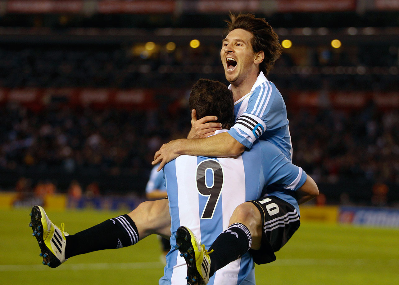 Argentina's Lionel Messi celebrates with Gonzalo Higuain after scoring against Ecuador during their World Cup qualifying match on June 2, 2012 in Buenos Aires, Argentina.