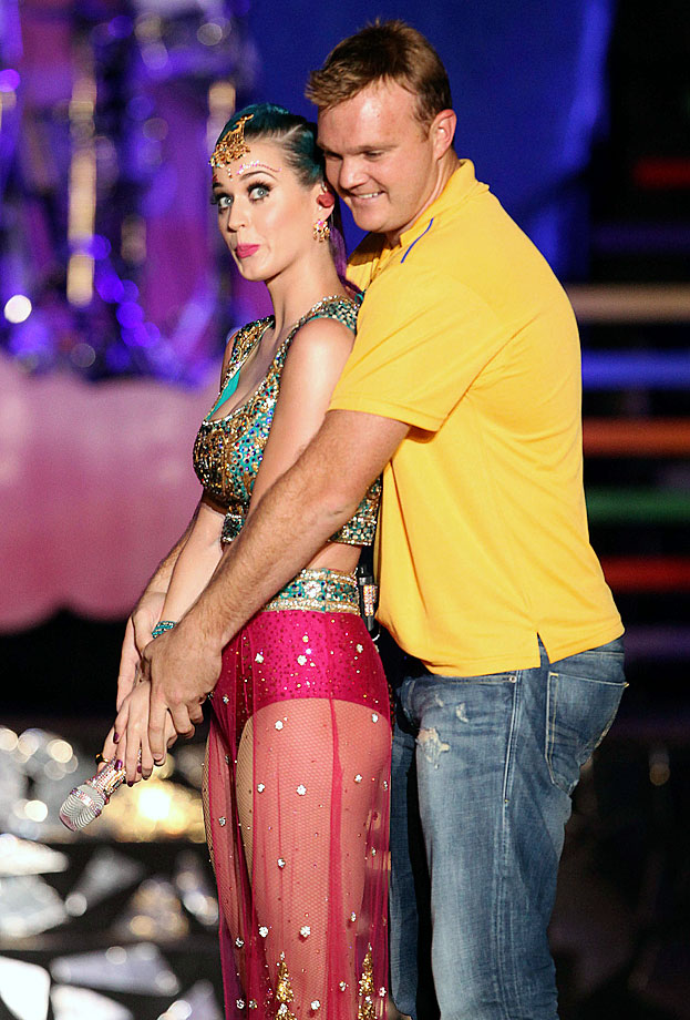 Katy Perry asks cricketer Doug Bollinger to show her how to bat during the Indian Premier League (IPL) opening night function and concert at the YMCA College of Physical Education Grounds on April 3, 2012 in Chennai, India.