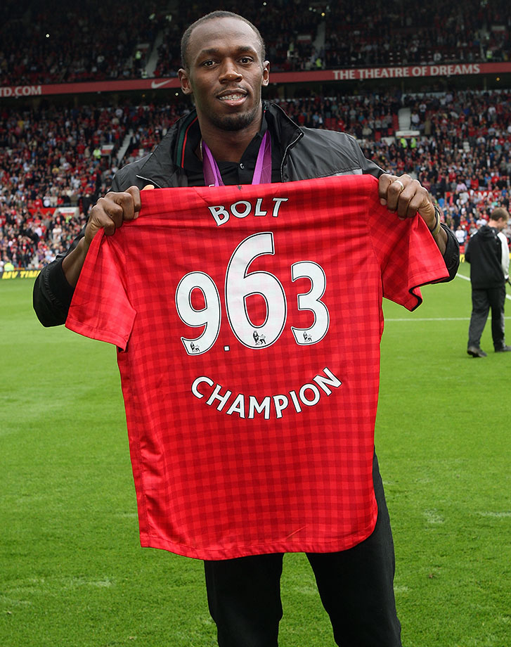 Bolt, a proud supporter of English Premier League giant Manchester United, poses on the pitch at Old Trafford ahead of a league match between Manchester United and Fulham. He is sporting a custom jersey embroidered with his Olympic gold medal-winning time of 9.63 seconds, which he set in the 100m at the London Games.