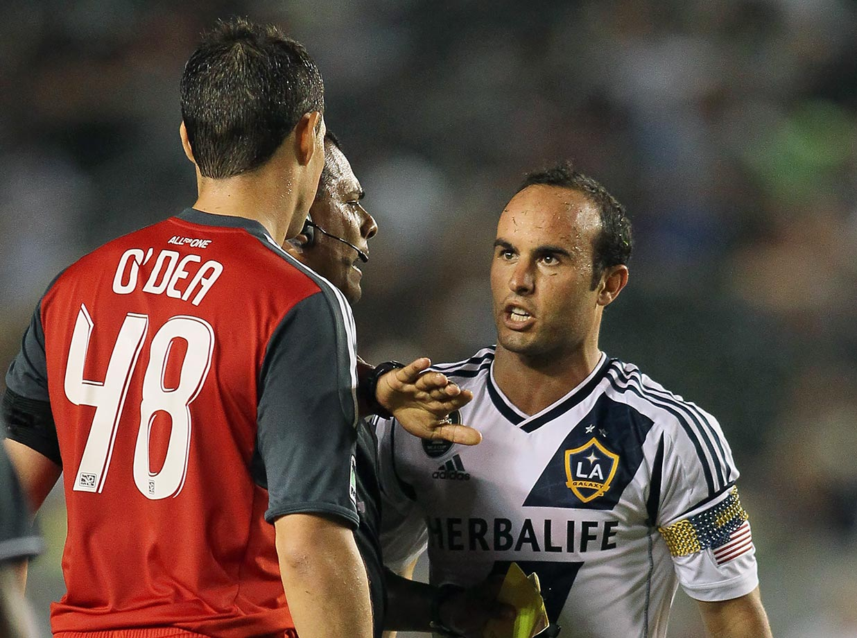 Referee Silvia Reyes gets between Landon Donovan and Toronto FC's Darren O'Dea after O'Dea tripped Donovan during an MLS match. The LA Galaxy defeated Toronto 4-2.