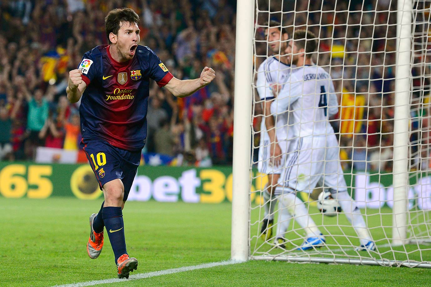 Barcelona's Lionel Messi celebrates after scoring against Real Madrid during their La Liga match on Oct. 7, 2012 at the Camp Nou stadium in Barcelona, Spain.
