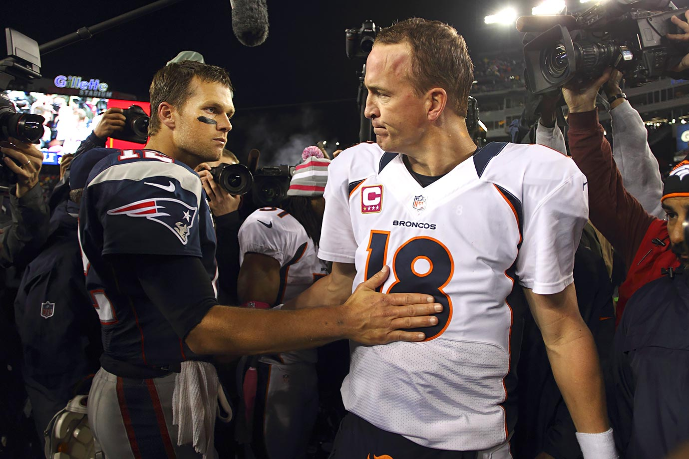 "In the first matchup following Peyton Manning's move from Indianapolis to Denver, Tom Brady's Patriots rolled to a 31-21 victory over the Broncos. Brady finished 23-of-31, with 223 yards passing and two touchdowns (one passing, one rushing). ""Nobody I'd rather have than Tom Brady,"" Patriots coach Bill Belichick said after the game. ""But Manning's a great player."" Manning, who sat out the entire 2011 season with a neck injury, went 31-of-44 for 345 yards and three touchdowns. (Brady 9, Manning 4)"