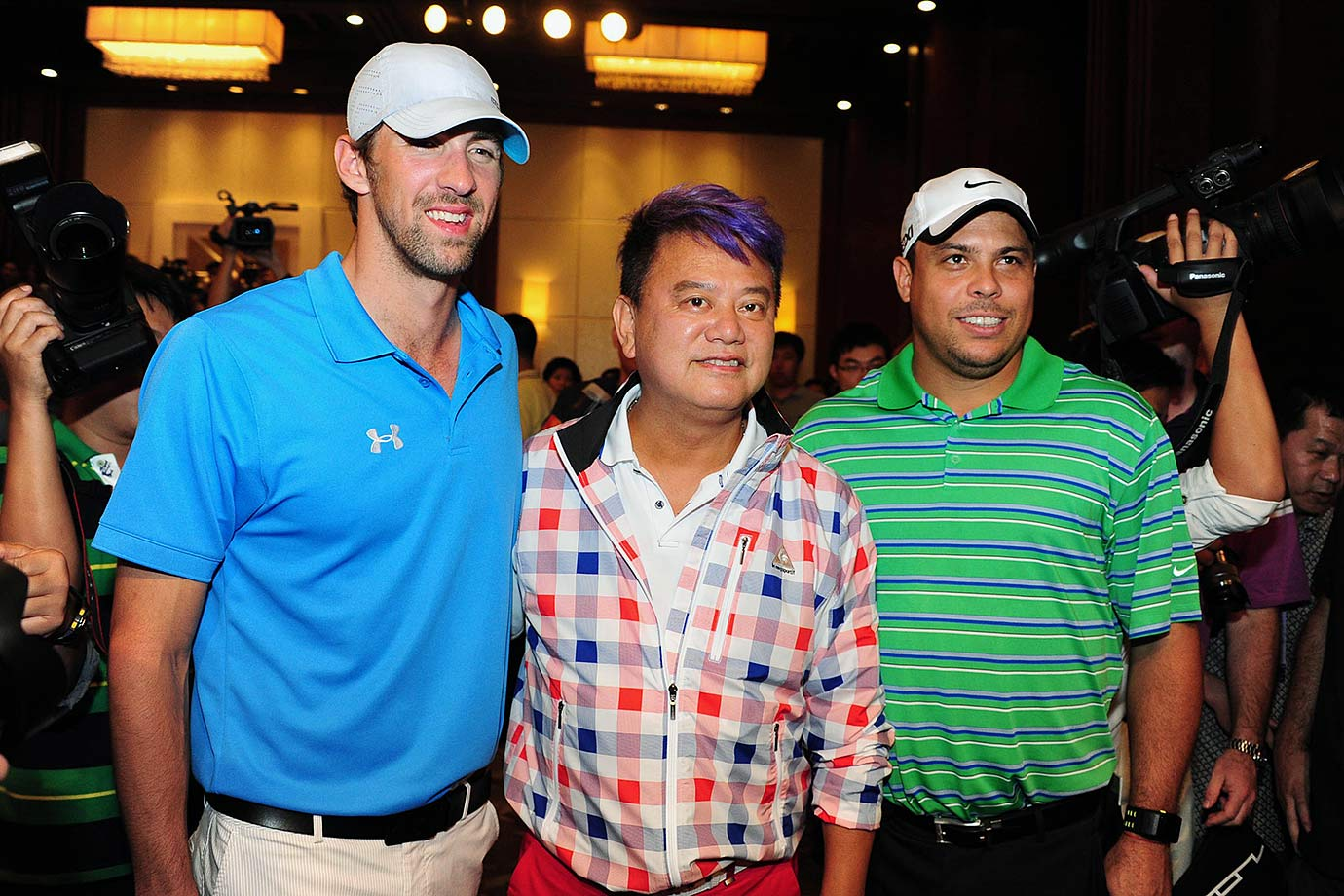 Michael Phelps, Natalis Chan and Ronaldo attend a press conference at the Mission Hills Golf Club in Haikou, China, in 2012.