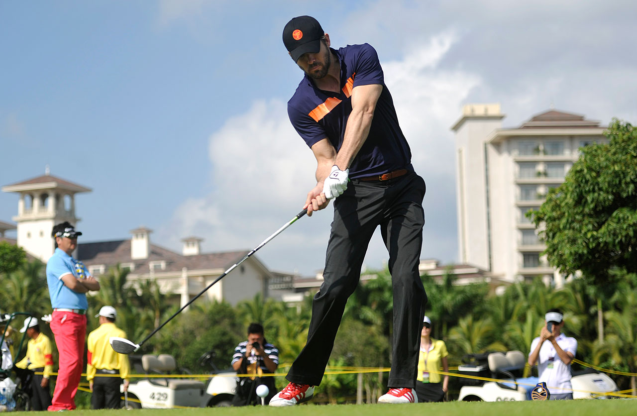 Ryan Reynolds tees off on Day 4 of the World Celebrity Pro-Am at Mission Hills Resort on Oct. 21, 2012 in Haikou, China.
