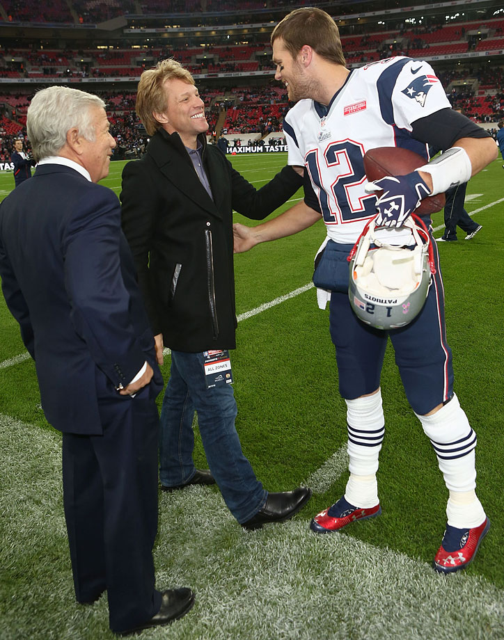 Jon Bon Jovi greets New England Patriots quarterback Tom Brady as owner Robert Kraft looks on before the Patriots game against the St. Louis Rams at Wembley Stadium in London, England.