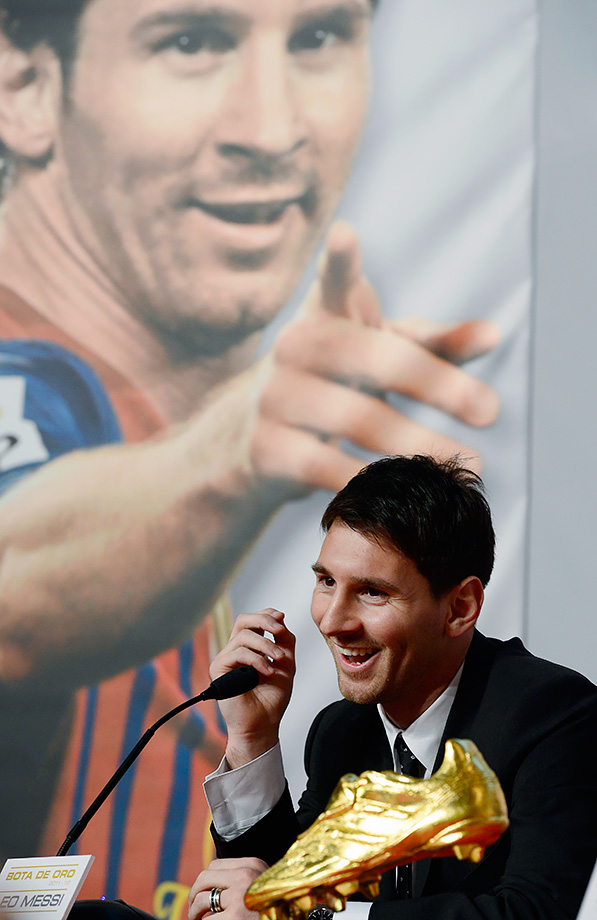Barcelona's Lionel Messi smiles during a news conference after receiving his Golden Boot award in recognition for scoring the most goals in Europe's domestic leagues on Oct. 29, 2012 in Barcelona, Spain.