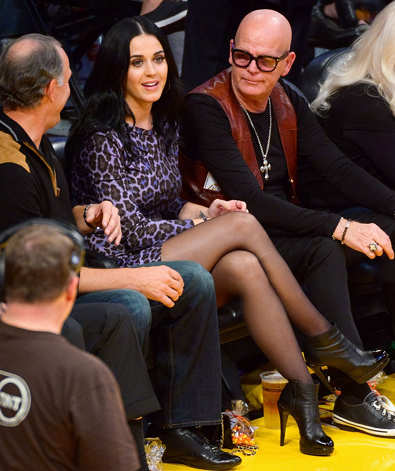 Katy Perry and her father, Keith Hudson, attend the Los Angeles Lakers game against the Dallas Mavericks at Staples Center Oct. 30, 2012 in Los Angeles.