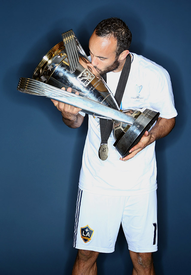 Landon Donovan kisses the MLS Cup after winning the 2012 title against the Houston Dynamo at The Home Depot Center in Carson, Calif.