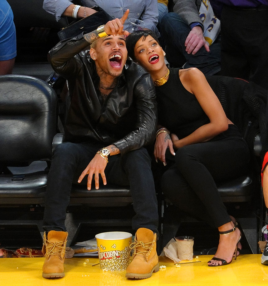 Chris Brown and Rihanna attend the Los Angeles Lakers game against the New York Knicks on Dec. 25, 2012 at Staples Center in Los Angeles.