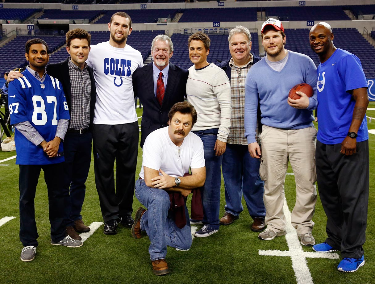 (Left to right) Aziz Ansari, Adam Scott, Andrew Luck, Jim Irsay, Nick Offerman, Rob Lowe, Jim O'Heir, Chris Pratt and Reggie Wayne pose together while filming the 'Parks and Recreation' episode ''Two Parties'' on Dec. 3, 2012 at Lucas Oil Stadium in Indianapolis.