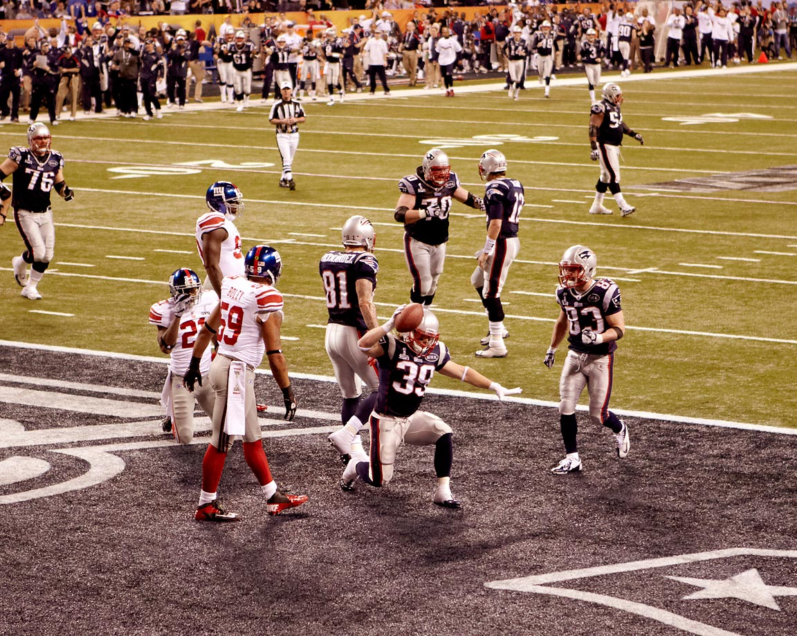Danny Woodhead spikes the ball after scoring a touchdown against the New York Giants.