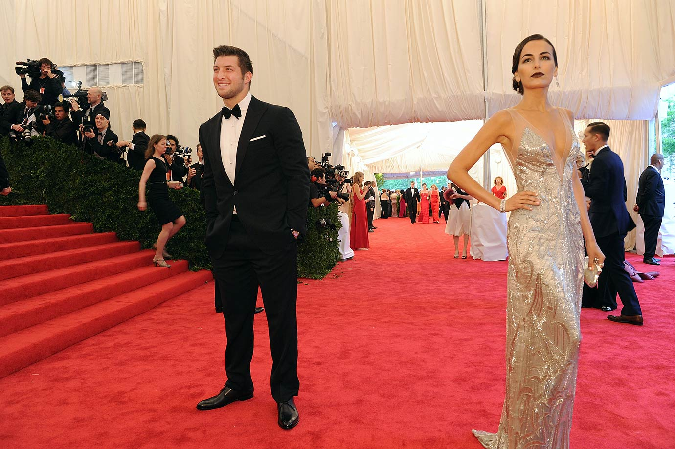 "Tim Tebow and girlfriend Camilla Belle attend the ""Schiaparelli And Prada: Impossible Conversations"" Costume Institute Gala at the Metropolitan Museum of Art in New York City."