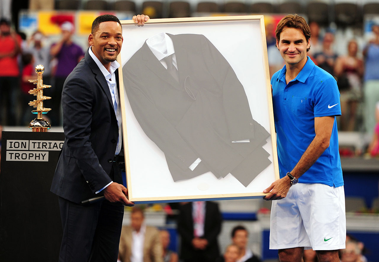 Will Smith and Roger Federer pose with Smith's suit worn in ''Men in Black III'' after Federer defeated Tomas Berdych in the Men's Single Final of the Madrid Open.