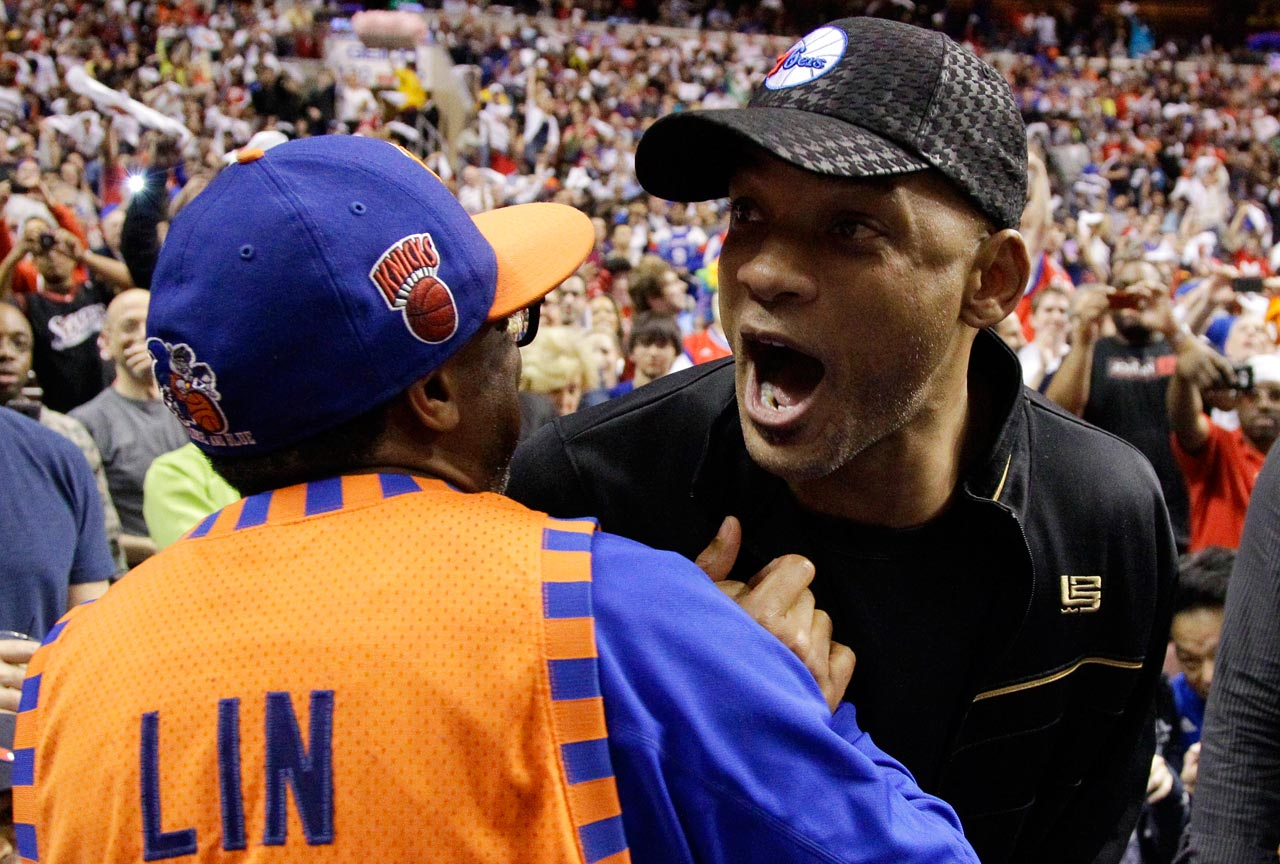 Will Smith speaks to Spike Lee during a timeout in the second half of a 76ers-Knicks game in Philadelphia.