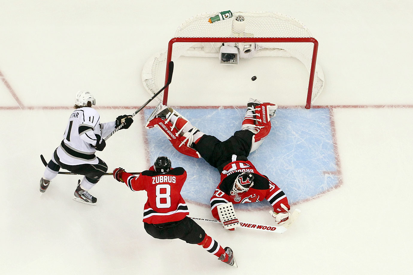 Three weeks after turning 40, Martin Brodeur, the Devils' franchise goaltender, took his team to the Cup final for the fifth time in his career. But in Game 1 at New Jersey's Prudential Center, Kings center Anze Kopitar got the upper hand, scoring the overtime winner against him. The Kings went on to win the Cup, four games to two.