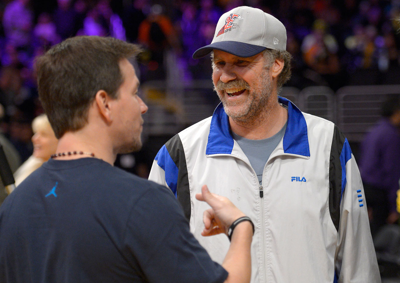 Will Ferrell talks with Mark Wahlberg prior to the Los Angeles Lakers game against the Denver Nuggets on Nov. 30, 2012 at Staples Center in Los Angeles.