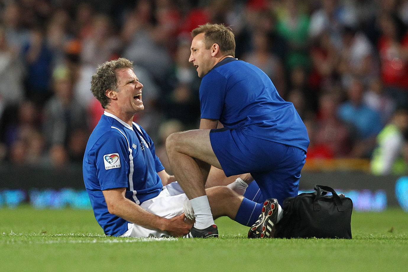 Will Ferrell receives treatment for a fake injury during the England vs. Rest of the World Soccer Aid, in aid of UNICEF, on May 27, 2012 at Old Trafford in Manchester, England.