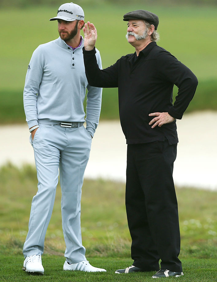 Bill Murray stands with Dustin Johnson during the first round of the AT&T Pebble Beach National Pro-Am golf tournament on Feb. 7, 2013 in Pebble Beach, Calif.