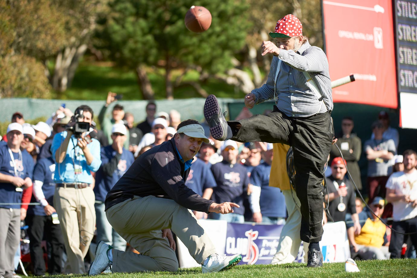 Bill Murray kicks a football with Harris Barton holding the ball during during the AT&T Pebble Beach National Pro-Am golf tournament on Feb. 9, 2013 in Pebble Beach, Calif.