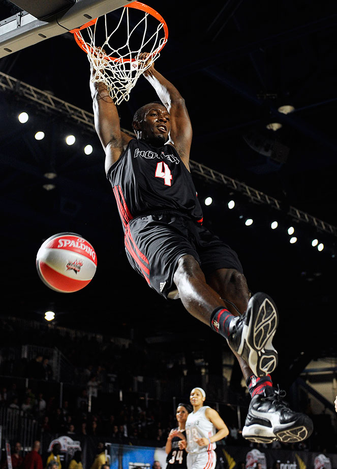 Bolt dunks during the first quarter of the 2013 NBA All-Star Celebrity Game in Houston.