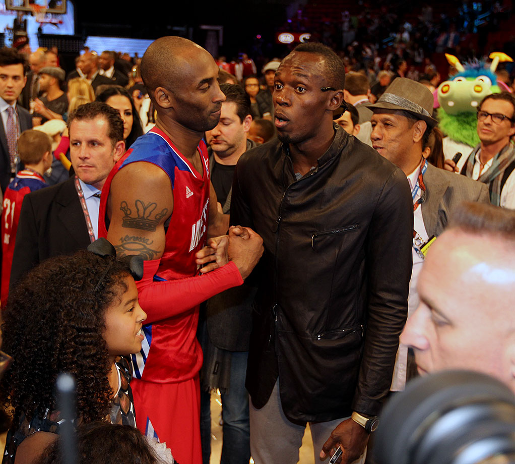 Bolt greets Los Angeles Laker and Western Conference All-Star Kobe Bryant after the 2013 NBA All-Star Game at the Toyota Center in Houston.
