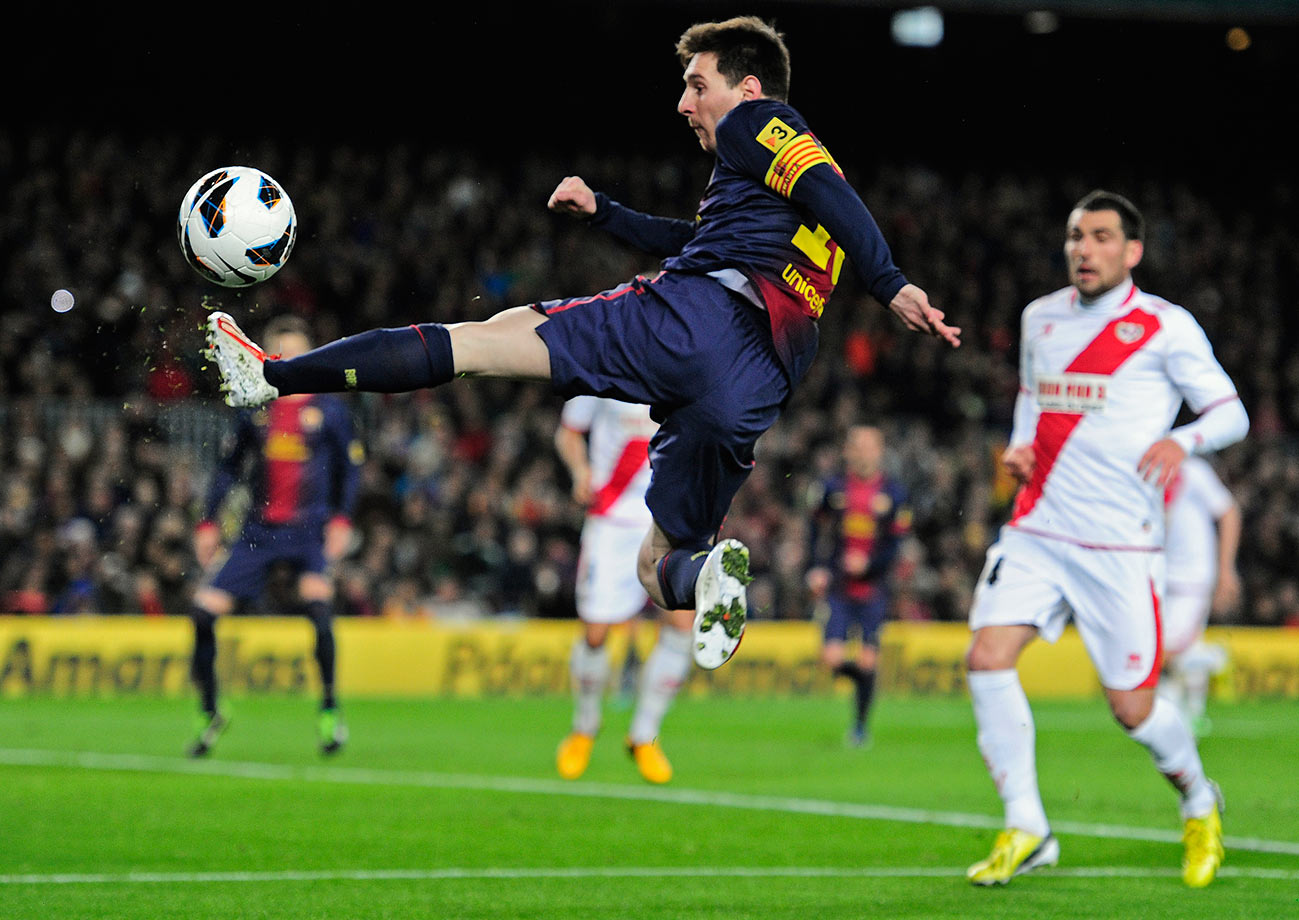 Barcelona's Lionel Messi kicks the ball during their La Liga match against Rayo Vallecano on March 17, 2013 at the Camp Nou stadium in Barcelona, Spain.