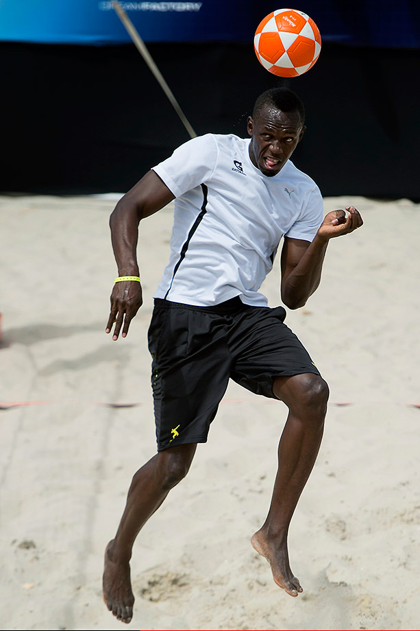 "Bolt plays footvolley during a ""Mano a Mano"" challenge at Copacabana Beach in Rio de Janiero."