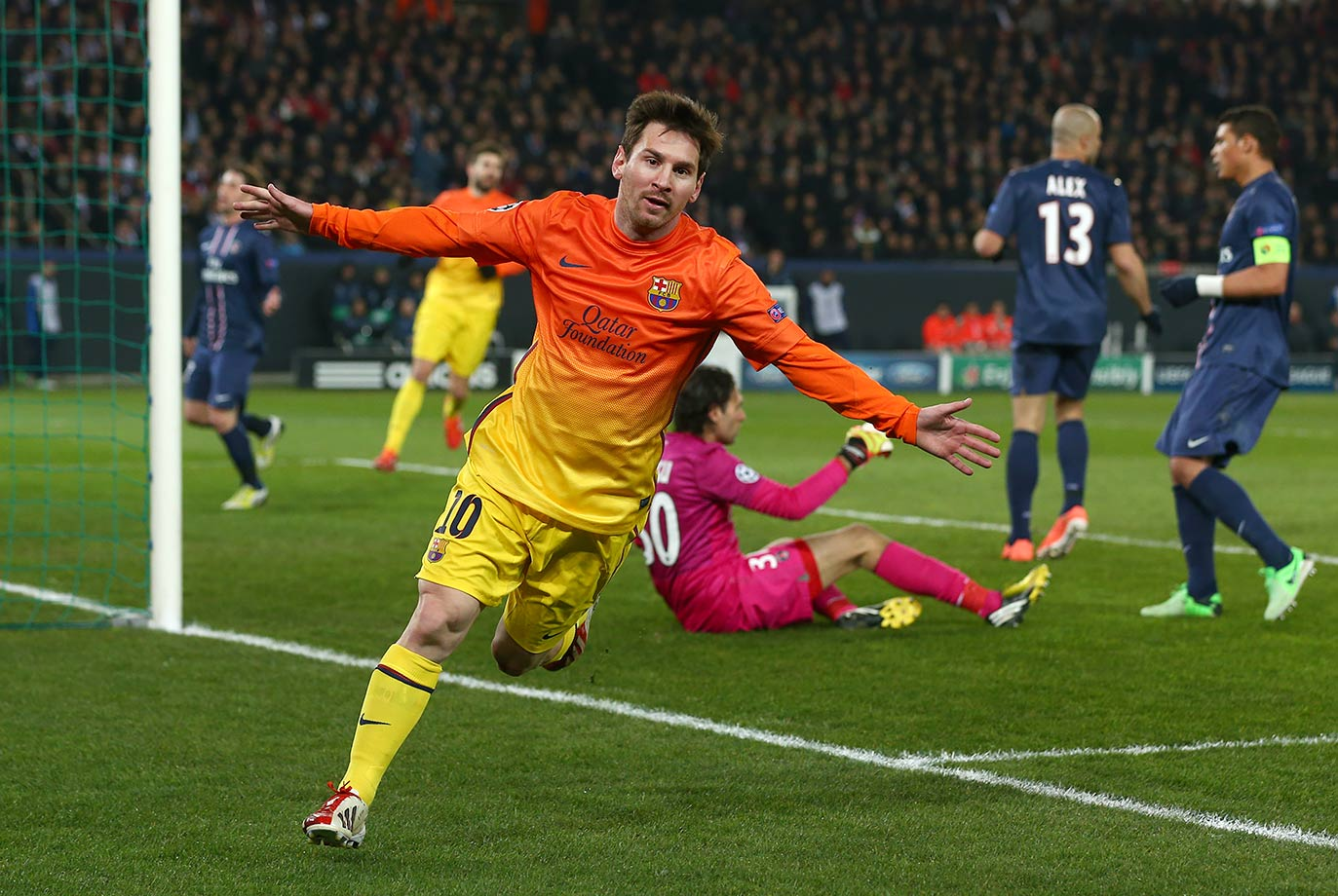 Barcelona's Lionel Messi celebrates scoring the opening goal during their UEFA Champions League quarterfinal match against Paris Saint-Germain on April 2, 2013 at Parc des Princes in Paris, France.