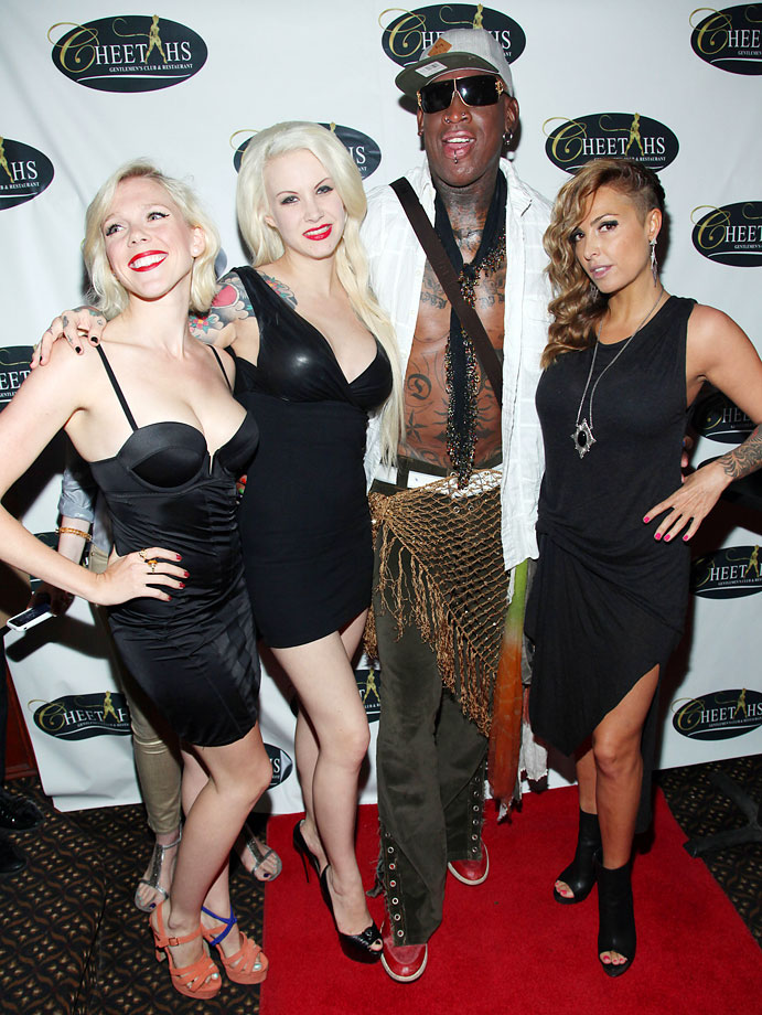 Rodman arrives for his 52nd birthday party in usual fasion.