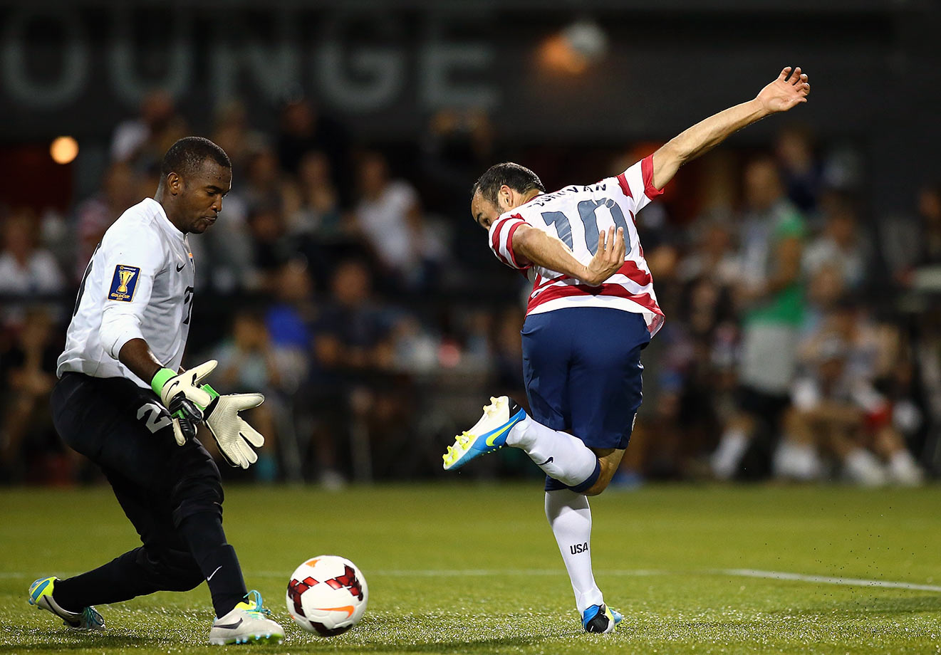 Landon Donovan attempts a back-heeled shot against Woodrow West of Belize during the 2013 CONCACAF Gold Cup in Portland, Ore. Donovan finished with a goal and two assists — becoming the first U.S. player to record both 50 goals and 50 assists for his career — as the U.S. won easily, 6-1.