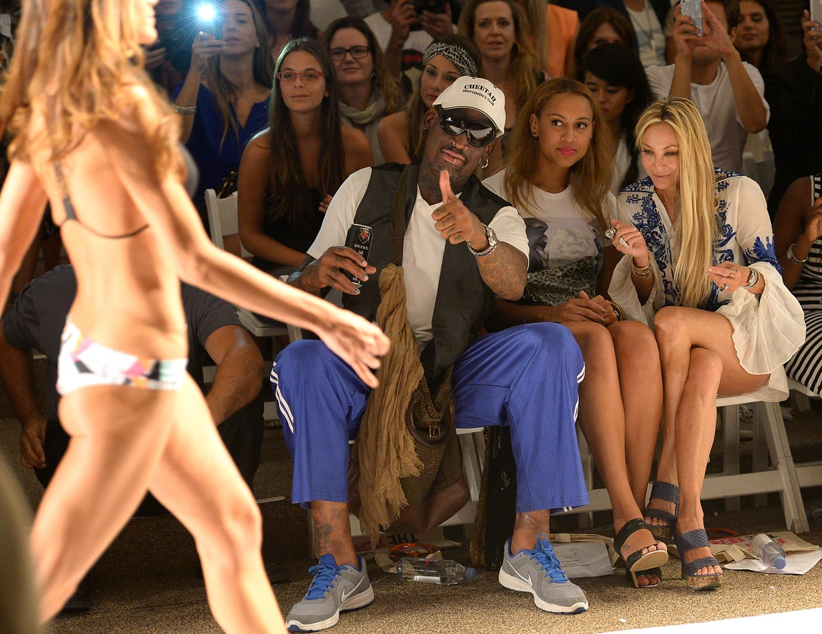 Rodman, sitting alongside his daughter Alexis and Lisa Pliner, likes what he sees at a swimsuit fashion show in Miami.